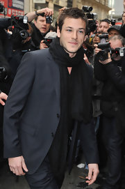 Looking as dashing as ever, Gaspard Ulliel wore a classic black scarf at the Chanel Show during Fashion Week in Paris.
