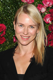 Naomi Watts styled her straight hair simply for the Chanel artist dinner at the 2012 Tribeca Film Festival.