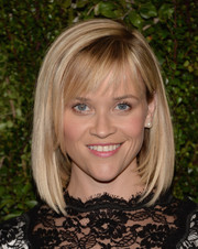 Reese Witherspoon went for classic styling with this mid-length bob and wispy bangs when she attended Drew Barrymore's book release party.