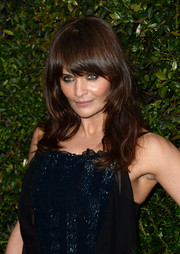 Helena Christensen kept it youthful and pretty with flippy bangs and gently waves during the Chanel and Charles Finch pre-Oscar dinner.