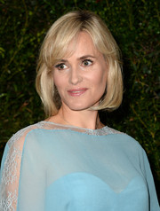 Judith Godreche attended the Chanel and Charles Finch pre-Oscar dinner wearing a bob with flippy bangs.