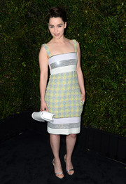 Emilia Clarke added a classic touch to her look with a quilted white Chanel clutch.