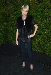 Kristin Chenoweth glammed up a simple blouse with a black fur vest for the Chanel and Charles Finch pre-Oscar dinner.