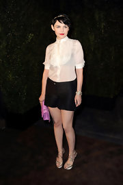 Ginnifer added shine with platform satin sandals.