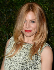 Sienna Miller sealed off her look with a swipe of bold red lipstick.