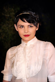Ginnifer Goodwin swept on a shiny scarlet lipstick for the Chanel and Charles Finch pre-Oscar Dinner.