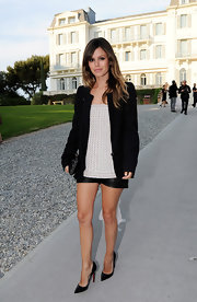 Rachel dons leather short shorts with her ensemble for the Chanel Resort Fashion Show.