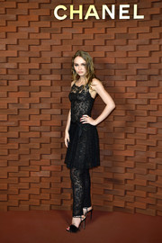 Lily-Rose Depp looked mature and chic in a little black lace dress at the Chanel Collection Metiers d'Art Paris Hamburg show.