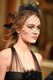 Lily-Rose Depp looked romantic wearing this loose ponytail, complete with a birdcage veil, at the Chanel Collection des Métiers d'Art show.