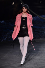 Barbara Palvin walked the Chanel Cruise runway wearing a striped red coat with ruched sleeves.
