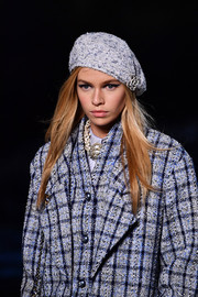 Stella Maxwell wore a blue tweed beret to match her suit at the Chanel Cruise runway show.
