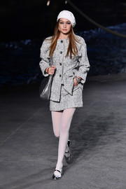 Gigi Hadid was business-chic in a gray tweed skirt suit while walking the Chanel Cruise show.