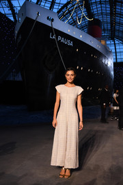 Phoebe Tonkin kept it breezy in a wide-leg jumpsuit by Chanel during the label's Cruise show.