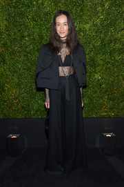 Maggie Q teamed a black cropped jacket with a sexy lace top and super-flared pants for the Tribeca Film Festival Chanel dinner.