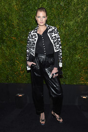 Constance Jablonski layered a splatter-print cropped jacket over a black button-down for the Tribeca Film Festival Chanel dinner.