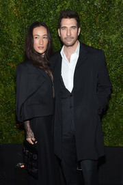Maggie Q attended the Chanel dinner at the Tribeca Film Festival carrying a unique black cutout velvet purse.