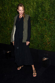 Uma Thurman looked tough in an army-green utility vest during the Tribeca Film Festival Chanel dinner.