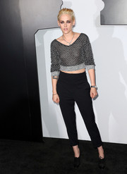 Kristen Stewart teamed her chic top with basic black slacks.