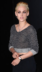 Kristen Stewart accessorized with an elegant rectangle-faced watch at the Chanel dinner.
