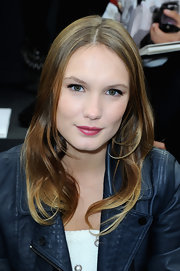 Ana Girardot added some color to her beauty look with pink lips, which simply popped against her fair skin.