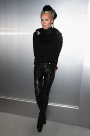 Daphne Guinness kept things interesting at the Chanel show in a pair of studded patent leather pants.
