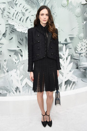 Stacy Martin was all business in a black tweed jacket layered over an LBD at the Chanel Couture show.