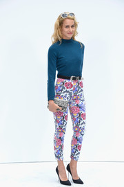 Alice Dellal wore floral pants with her sweater for a chicer finish.