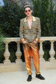 Kristen Stewart added major shine with a pair of metallic ombre leather pants, also by Chanel.