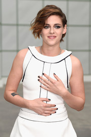 Kristen Stewart teamed black nail polish with smoky eyes and a tousled hairstyle for major edge during the Chanel Couture show.