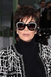 Kris Jenner added a dose of fun with a pair of pearl-embellished cateye sunnies by Chanel.