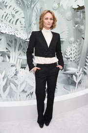 Vanessa Paradis layered a black cropped jacket over a high-neck white blouse for her Chanel Couture fashion show look.
