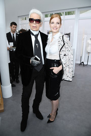 Jessica Chastain was classic in a semi-sheer white button-down while attending the Chanel Couture show.