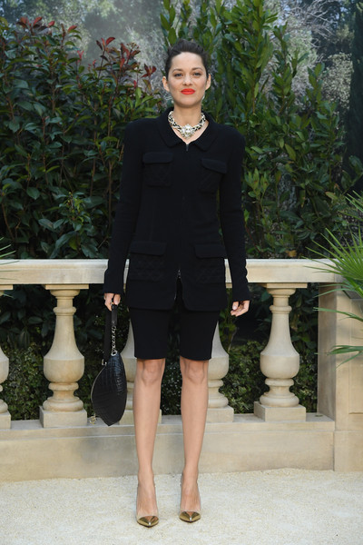 Marion Cotillard showed off her legs in a black tweed short suit by Chanel during the brand's Couture Spring 2019 show.