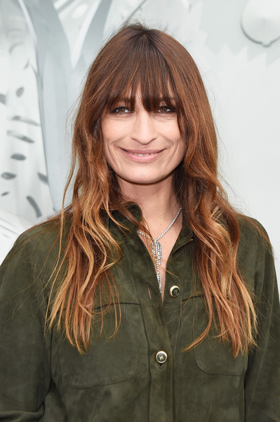 Caroline De Maigret sported boho waves with eye-skimming bangs during the Chanel Couture show.