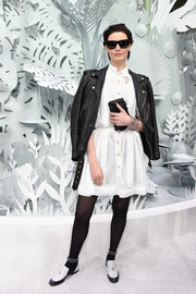 Erin O'Connor toughened her dress with a black leather moto jacket, also by Chanel.