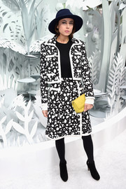 Anne Berest's quilted yellow clutch provided a nice pop to her monochrome outfit.