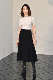 Olga Kurylenko gave her look a rocker edge with a pair of laced suede boots.