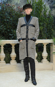 Tilda Swinton completed her outfit with a pair of chain-embellished knee-high boots, also by Chanel.