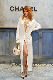 Rihanna chose an off-white, full-length cardigan for her sexy look at the front row of the Chanel Haute Couture show.