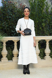 Tessa Thompson kept it simple yet chic in a white cardigan by Chanel during the brand's Couture Spring 2019 show.