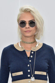 Cara Delevingne rocked a slightly messy ice-blonde bob at the Chanel fashion show.