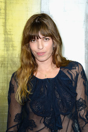 Lou Doillon wore eye-skimming bangs and subtle waves during the Chanel fashion show.