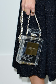 Miroslava Duma attended the Chanel fashion show carrying this delightful perfume bag.