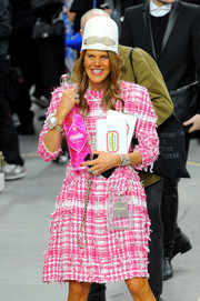 Anna dello Russo attended the Chanel fashion show sporting this perfume bag and tweed dress combo from the label.