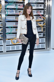 For her bag, Carla Bruni-Sarkozy chose a distressed taupe leather clutch by Chanel.