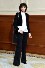 Ines de la Fressange layered a black cropped jacket over a white silk blouse for her Chanel fashion show look.