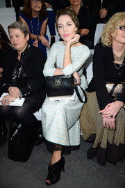 Ulyana Sergeenko completed her look with a vintage-chic quilted black Chanel bag.