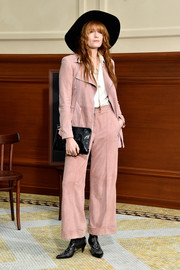 Florence Welch attended the Chanel fashion show rocking a baggy pink pantsuit from the label.