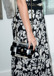 Katy Perry accessorized with an on-trend Chanel Lego chain-strap bag during the label's fashion show.