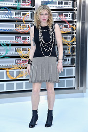 Courtney Love teamed her dress with a pair of black cap-toe ankle boots.